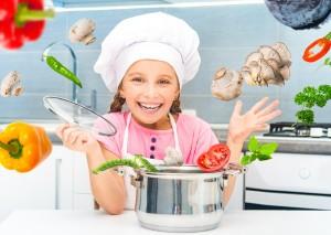 Little girl preparing vegetable soup
