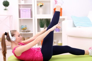 Young woman exercise at home