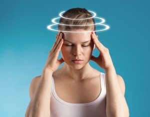 Woman suffering from dizziness