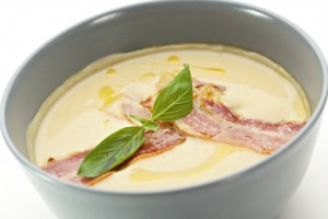 Bowl of creamy soup with bacon