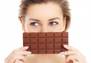 Woman holding a chocolate bar