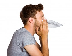 A man blowing nose