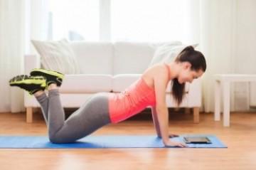 Girl doing push-ups at home