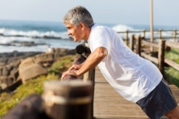 Senior man exercising on the coast